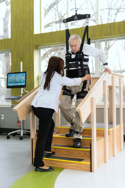 Aretech ZeroG being used with a man on stairs