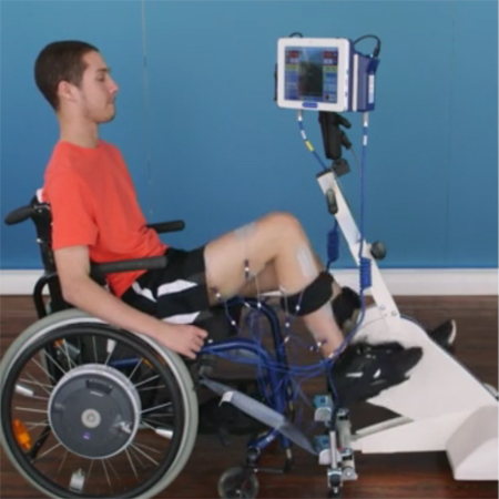 Man in wheelchair using the Leg Cycle
