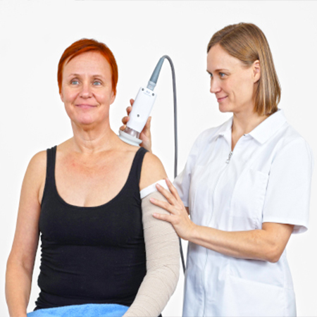 Woman receiving a medical procedure with the PhysioTouch on her back