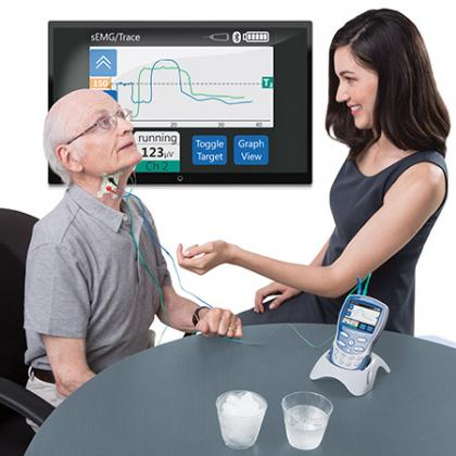 Man using the VitalStim with a woman therapist