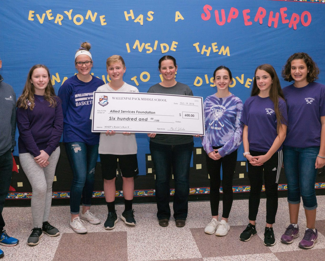 Wallenpaupack middle school students pose with large check