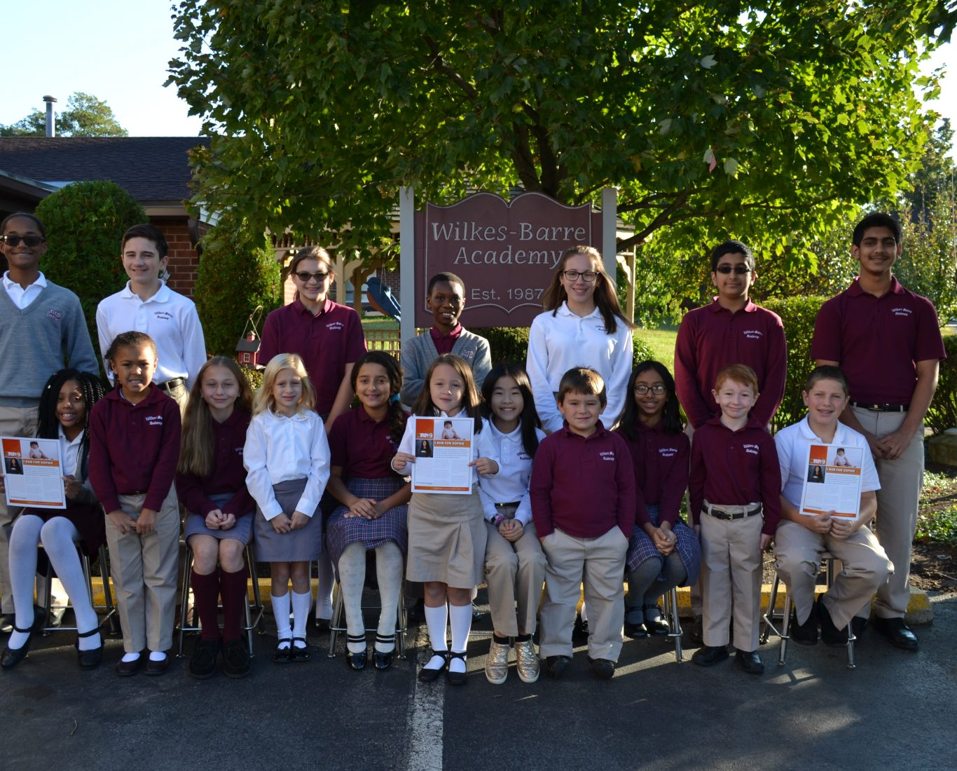 Wilkes Barre Academy students pose in front of school sign