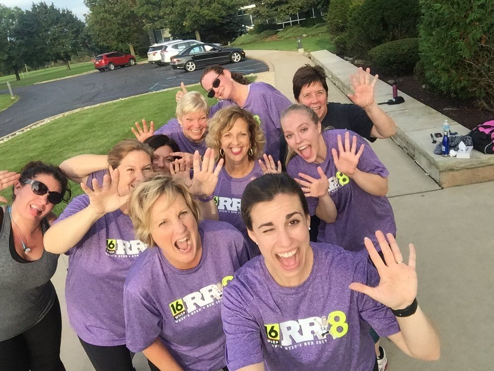 Jaclyn Henry (front, right) gets a group of Allied employees ready to take on their first 5K.