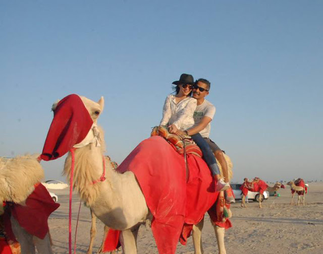 With wifey at Messaieed, Qatar on a camel